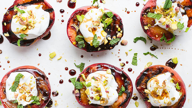 Grilled Peaches with Balsamic, Coconut, + Pistachios